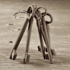 old and rusty keys, in sepia tone